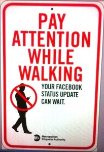 Street Sign: Pay Attention While Walking--Your Facebook status update can wait