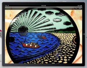 Image of a colorful Japanese manhole cover on an iPad